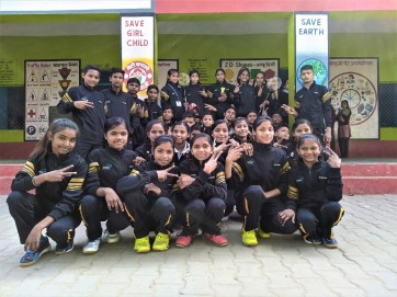Sports team of the school posing with their brand new sports shoes and tracksuits